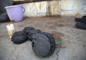 Antipersonnel landmines in front of a shop used to store shells and landmines by Taher Humaid, who heads the Taizz National Association for Demining, June 11, 2016.