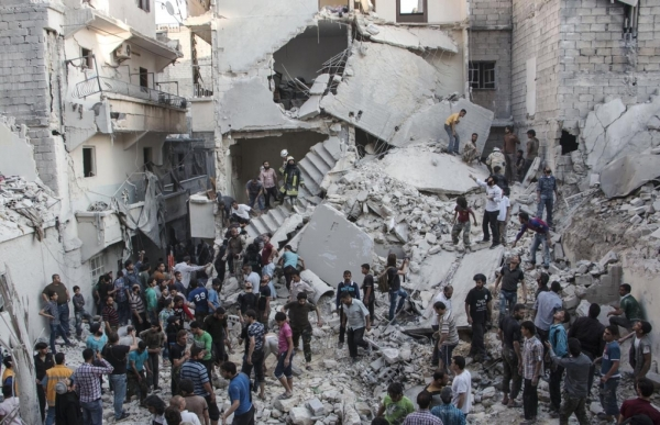 Civilians gather after an incident of violence from explosives in Syria.