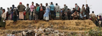 Rohingya refugees at Balukhali Camp wait in line for daily essentials distribution