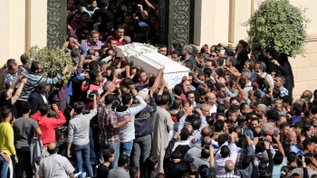 Mourners attend the funeral of those killed in the bus attack targeting Coptic Christians
