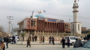 Security forces outside the the Baqir ul-Uloom mosque, following the suicide attack which killed over 30 worshippers