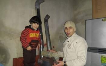 A man and his son seek refuge from the bombardment in eastern Ghouta.