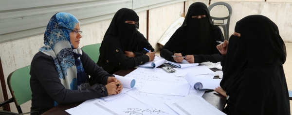 Women in Yemen engage in dispute mediation.