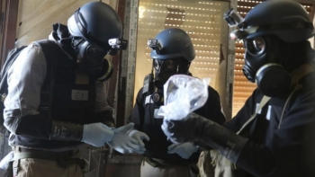 OPCW experts collecting samples from one of the sites of an alleged chemical attack