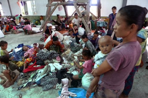 Residents who fled from conflict areas in Karen State take refuge at an evacuation centre in a monastery