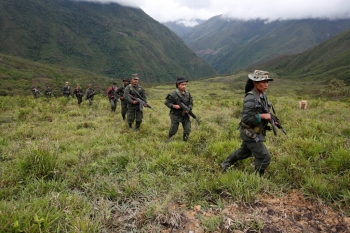A group of guerrilleros walking through the Colombian mountains