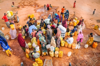 Somali refugees in Dadaab Camp, waiting to get in the water