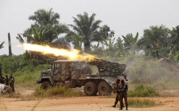 Congolese soldiers from the Armed Forces of the Democratic Republic of Congo (FARDC) launch missiles during their military operation against ADF-NALU rebels outside the town of Beni, in North Kivu province