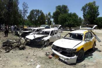 Damaged vehicles pictured after the suicide car bomb attack in Khost