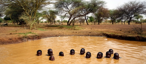 Children swimming in a waterhole in Burkina Faso.