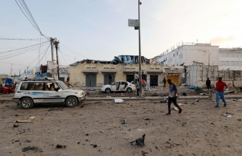 The aftermath of the explosion of three bombs in the streets of Mogadishu.