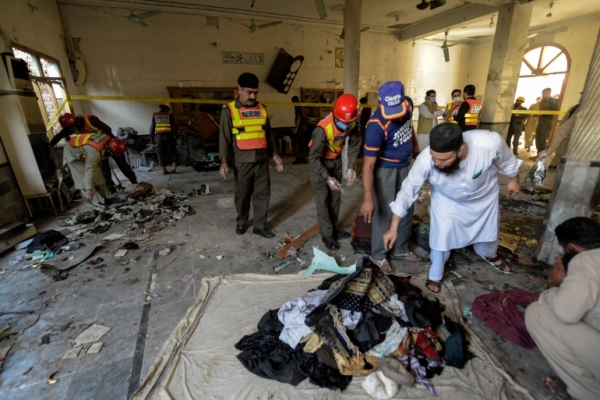 Rescue workers in the mosque after the blast, Peshawar, Pakistan