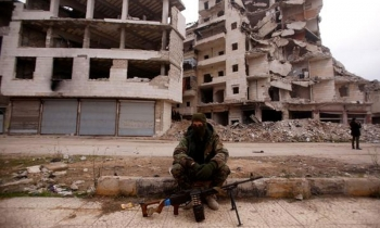 A soldier in the city of Aleppo