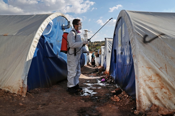 Disinfection practices at a camp for displaced people in Kafr Jalis village, Syria