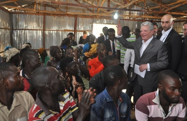 Germany's President Joachim Gauck during a visit to a camp of displaced people on the outskirts of Abuja, Nigeria.