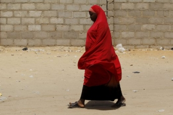 A woman walking in Maiduguri camp, Nigeria