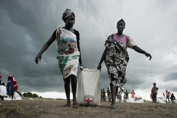 Two South Sudanese women receiving aid for the Red Cross