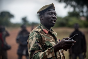 General Moses Lojuko of the rebels speaks to troops in Loopo town of Kajo Keji county.