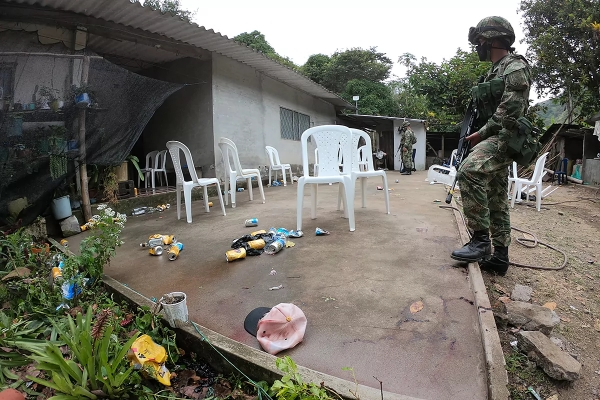 Colombian soldier inspects the Samaniego crime scene in southwestern Colombia