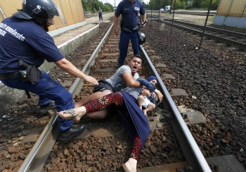 Hungarian policemen stopping syrian refugees