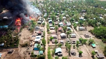 A fire burns in a village in the Rakhine State of Myanmar
