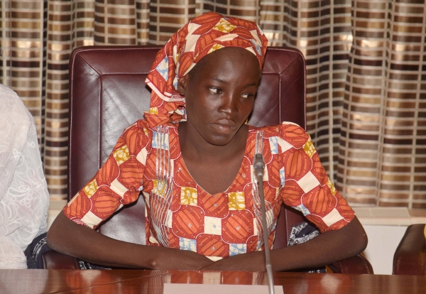Amina Ali, the rescue Chibok school girl, sits during a meeting with Nigeria's President Muhammadu Buhari at the Presidential palace in Abuja, Nigeria