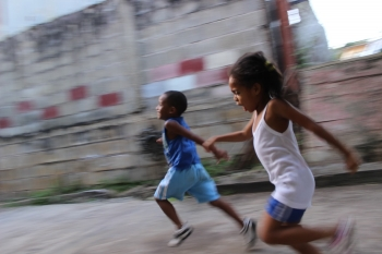 Two african children while running