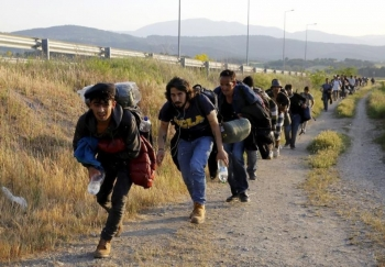 A group of migrants from Syria trying to avoid Greek patrols at the border with Macedonia