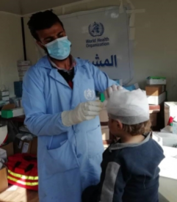 Medical team treating child at Al-Hol camp, Northeast Syria