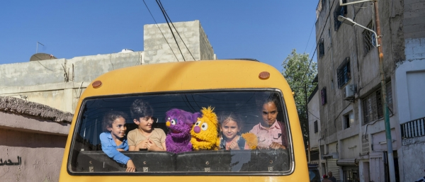 Ryan Donnell/Sesame Worshop Children interact with Jad, one of the main characters of the show Ahlan Simsim
