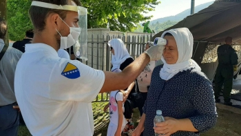 Temperature check at the entrance of the Srebrenica Memorial Centre on the day of the commemorations