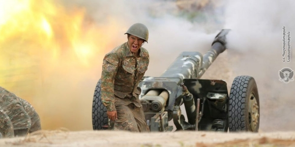 Armenian soldier firing an artillery piece during fighting with Azerbaijan's forces