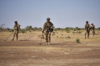 French soldiers search for improvised explosive devices (IEDs) in the Sahel region