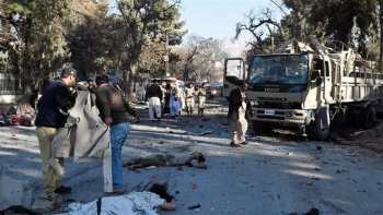 TTP has increased its attacks in the Balochistan province over the past year. Pakistani security officials stand beside the bodies of blast victims at the site of a bomb explosion