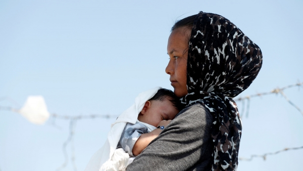 An Afghan woman and her child in a refugee camp in Lesvos, Greece