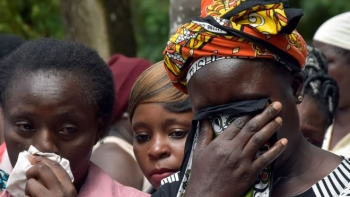 Family members grieving outside of Kakamega County Referral Hospital