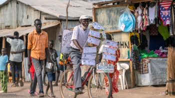 Djuba Alois, a 75-year-old pastor, preaches on his bicycle during COVID-19 pandemic in Kakuma refugee camp (Kenya).