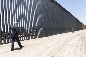 President Trump walks along the completed 200th mile of new border wall along the U.S.-Mexico border on 23 June 2020