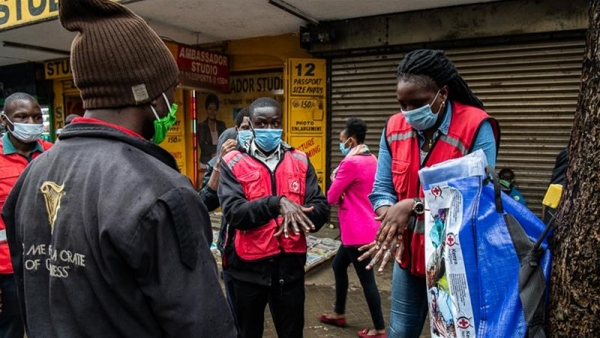 A member of Kenya Red Cross demonstrates hand-washing in Nairobi, Kenya