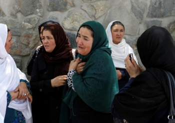 Afghan women mourn outside a hospital after the truck bomb in Kabul