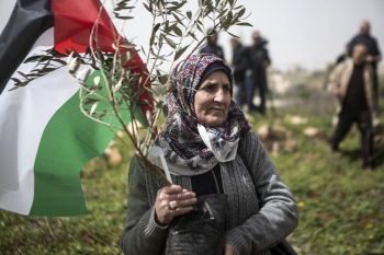 A woman holding a Palestinian flag