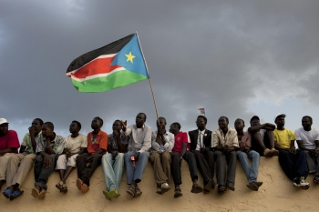 Men wave South Sudanese flag amid 2018 peace negotiations