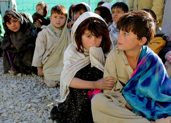 Afghanistan children waiting for food at Camp Clark, Khowst province, Afghanistan
