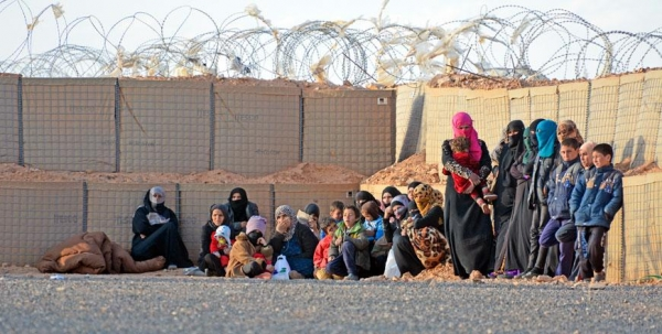 Syrian women with their children in the Rukban camp
