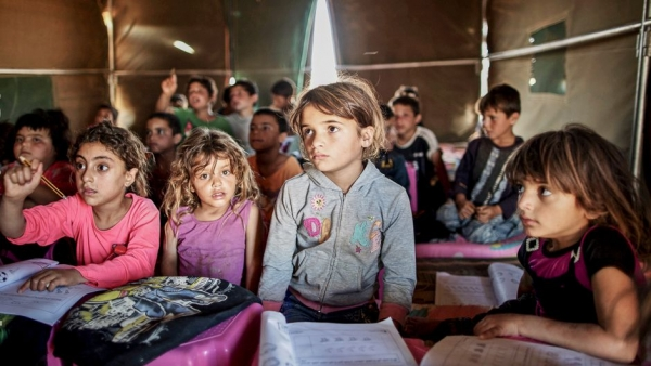 Syrian children attending a class in a refugee camp in Mafraq, Jordan: