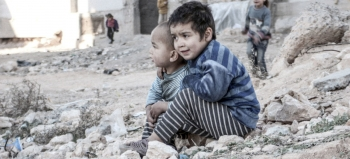 Two children near a shelter for internally displaced people in Aleppo