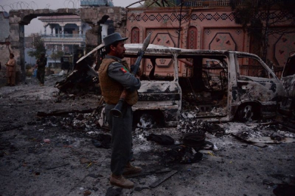 The van blasted by the attackers in front of the Save the Children Jalalabad office