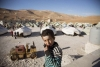 A Syrian boy at a refugee transit site in Arsal, Lebanon