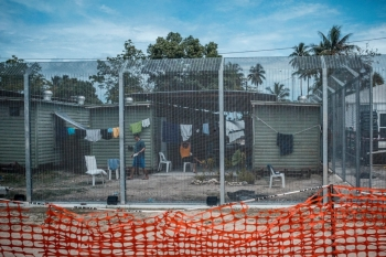 Asylum seekers sit in the regional processing centre on Manus Island