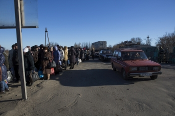 Civilians standing in the queue on a cold, winter day